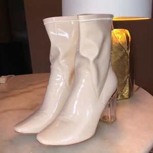 NWOT patin leather nude booties